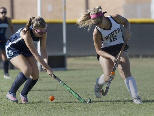 Lexi Banta (No. 16) tries to take the ball away from