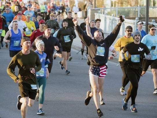Runners make their way at the start of Saturday's Pensacola