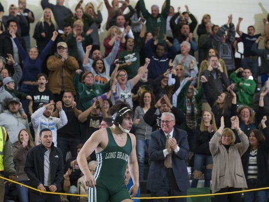 Long Branch's Daniel Santos-Silva, receives the cheers