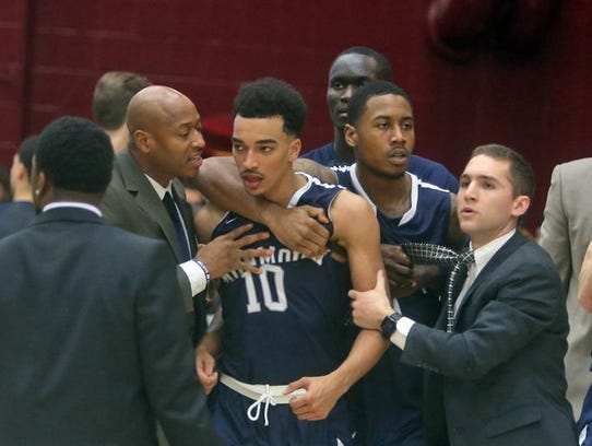 Monmouth assistant coach Duane Woodward  (left) speaks