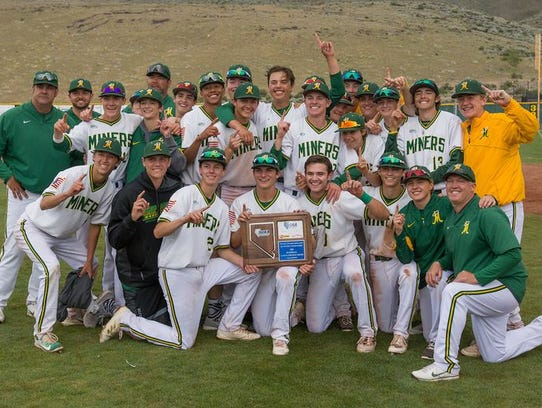 The Miners celebrate after winning the Northern 4A