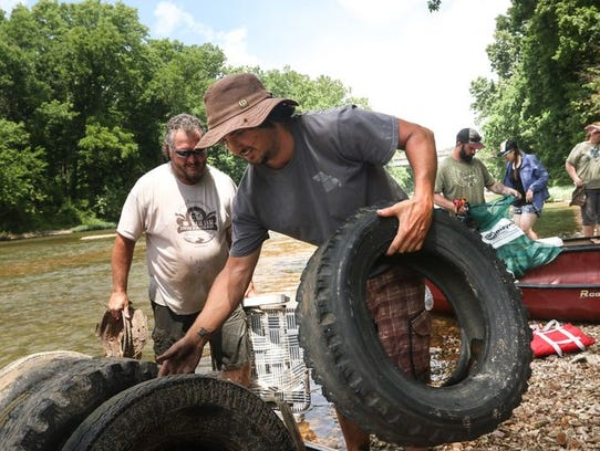Volunteers pulled a bunch of tires from the James River