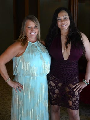 Mustang Ranch madam Jennifer Barnes and Ayana, an independent contractor at the Mustang Ranch, pose for a photo on July 5, 2018.