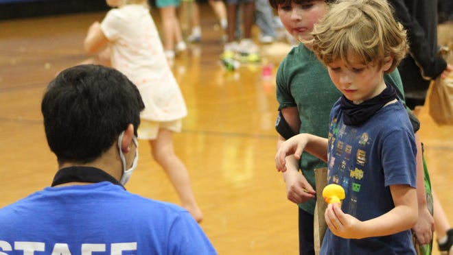 A boy plays the Pick-A-Ducky game Sept. 25 at the Boys & Girls Club of Durant.