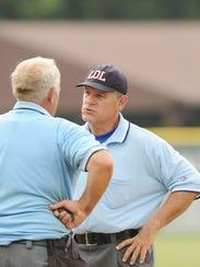 Land O Lakes base Umpire Mike Biagioli talking bewteen