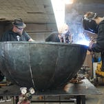 The Knapp family works in their Milwaukee Blacksmith shop in the Third Ward. The family and their shop is the focus of a new History channel reality series that premieres Aug. 23.