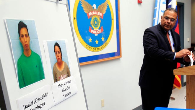 McAllen Police Chief Victor Rodriguez displays photos of Daniel Guardiola Dominiguez, left, and Mary Carmen Garcia, who were arrested Sunday after arriving at the border with fraudulent credit cards that were produced using data stolen during the Target security breach late last year.