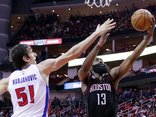 Detroit Pistons' Boban Marjanovic (51) defends on a shot by Houston Rockets' James Harden (13) during the second half of an NBA basketball game Friday, April 7, 2017, in Houston. (AP Photo/Michael Wyke)