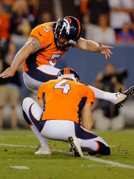 In this photo taken Saturday, Aug. 23, 2014, Denver Broncos kicker Matt Prater (5) boots the ball during the first half of an NFL preseason football game against the Houston Texans in Denver. Prater is facing a four-game suspension for violating the league's substance abuse policy, according to the Denver Post. The Broncos declined to comment on the report, and neither Prater nor his lawyer, Harvey Steinberg, replied to text messages from The Associated Press early Sunday morning. (AP Photo/Jack Dempsey)