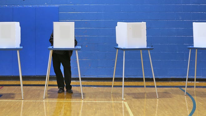 A voter casts his ballot at the Douglass Park Community Center on Election Day in 2014.