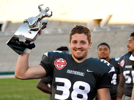 National team's Troy Apke, left, of Penn State, holds up his MVP trophy along with several after the National team defeated the American team 23-0 in the Collegiate Bowl college football game, Saturday, Jan. 20, 2018, in Pasadena, Calif. (AP Photo/Mark J. Terrill)