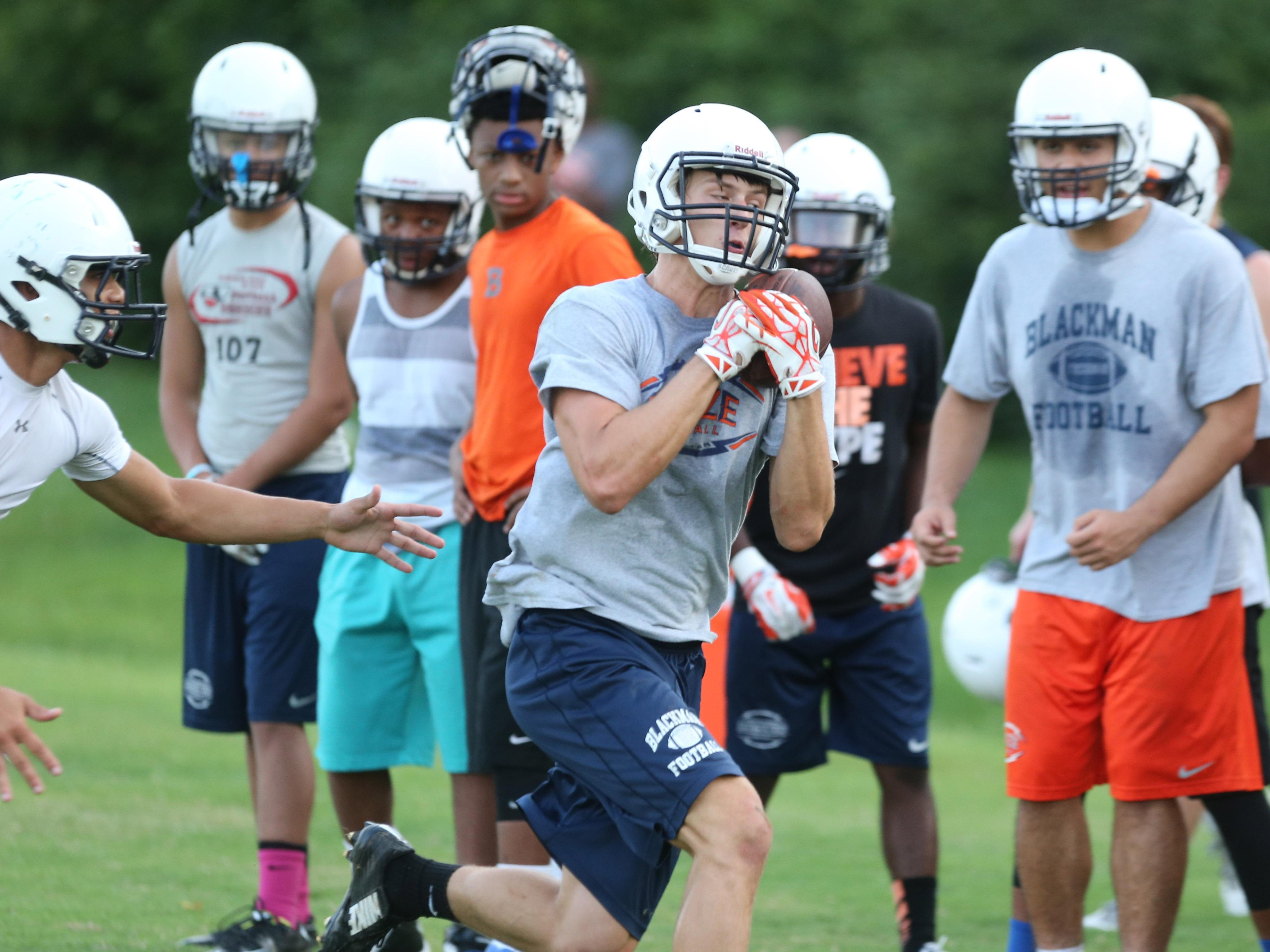 Blackman wide receiver Michael Harris pulls in a pass during Monday's practice.