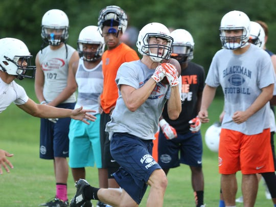 Blackman wide receiver Michael Harris pulls in a pass