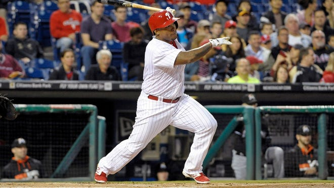 Philadelphia Phillies right fielder Marlon Byrd hits an RBI double during the first inning against the Miami Marlins at Citizens Bank Park.