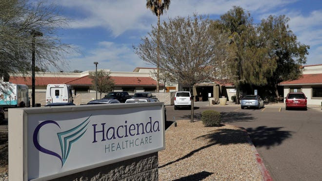 This Jan. 25, 2019, file photo shows the Hacienda HealthCare facility in Phoenix. Arizona is contesting a long-term care facility's decision to shut down the unit where an incapacitated woman was raped and later gave birth.