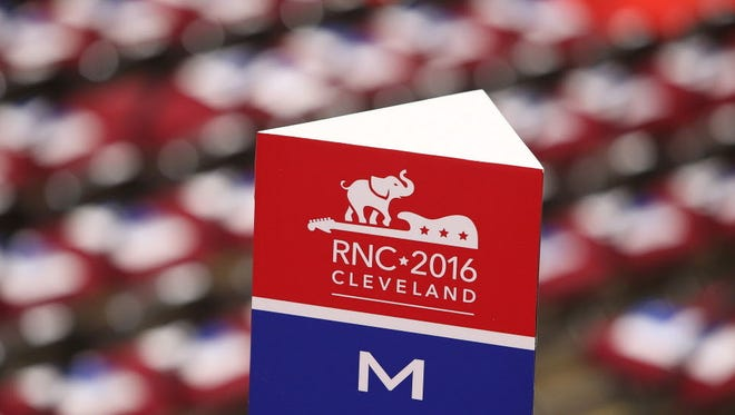 The Michigan delegation sign inside Quicken Loans Arena before the start of the roll call vote for the 2016 Republican National Convention. Following the convention, local Republican candidates and a state representative for the Donald Trump campaign will open a joint campaign office in Loveland on Monday, July 25.