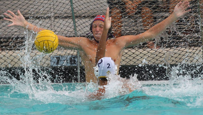 Derek Van Buskirk of Shadow Hills goes for the block in a game against La Quinta earlier this season. The Knights play in a Division 7 semifinal Wednesday.