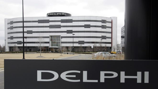In this March 22, 2006, file photo, Delphi's World Headquarters is shown in Troy, Mich. Automotive electronics and parts maker Delphi and French transport company Transdev have plans to use autonomous taxis and a shuttle van to carry passengers on roadways in France without a human behind the wheel as early as 2018. The companies announced the partnership Wednesday, June 7, 2017, and said it could be the first deployment of autonomous taxis and vans on real roads without human backup pilots. (AP Photo/Carlos Osorio, File)