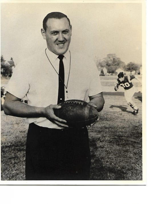 Max Ross holding football