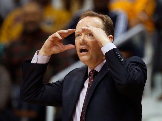 Atlanta Hawks head coach Mike Budenholzer reacts in the second half of an NBA basketball game against the Los Angeles Lakersm Friday, Dec. 4, 2015, in Atlanta. Atlanta won 100-87. (AP Photo/John Bazemore)