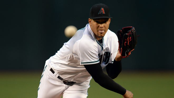 Apr 21, 2017: Arizona Diamondbacks starting pitcher Taijuan Walker (99) pitches against the Los Angeles Dodgers during the first inning at Chase Field.