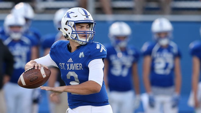 St. Xavier quarterback Chase Wolf (2) drops back to throw in the first quarter during the high school football game between the Elder Panthers and St. Xavier Bombers, Friday, Sept. 29, 2017, at at St. Xavier High School in Springfield Township, Ohio.