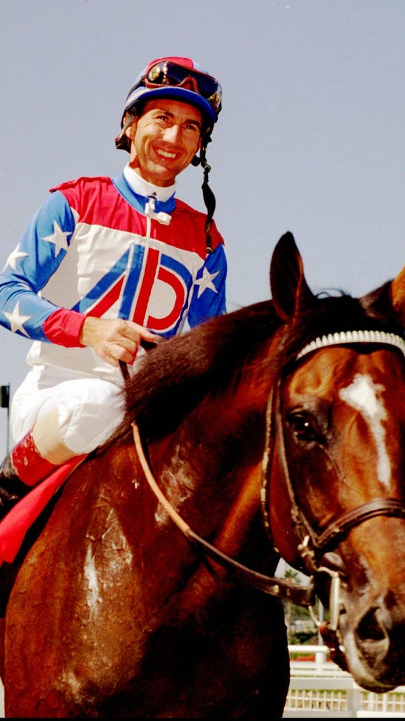 Jerry Bailey smiles broadly as he and Cigar are led to Winner's Circle after they won the $1 million Hollywood Gold Cup on July 2, 1995, at Hollywood Park in Inglewood, Calif.