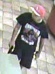 This man is wanted by police for a robbery at a Taco