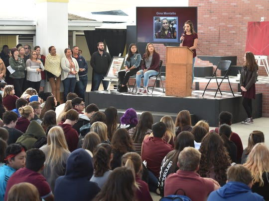 "Maddie Stromak, 17, (center) a senior at Indian River Charter High School, leads the opening of the school's Walk-In, on Wednesday, March 14, 2018, to honor the 17 shooting victims at Marjory Stoneman Douglas High School in Parkland. ""What happened that day must never be forgotten and must never happen again,"" Maddie said. More than 650 students and faculty participated in the ceremony that began at 10 a.m. under the dome of the school's courtyard. To see more photos, go to TCPalm.com."