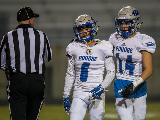 Poudre High School defensive back Caden Oliver (14) comforts kick returner Zack Leal (6) after losing a fumble against Pomona High School on a return, Friday, Nov. 10, 2017, at the North Area Athletic Complex in Arvada, Colo.