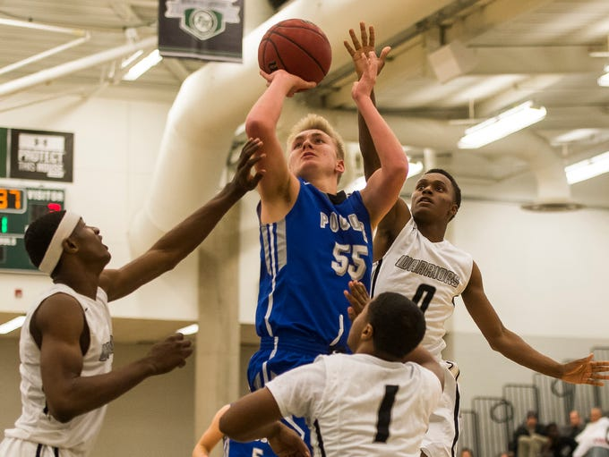 Poudre High School junior Jack Fisher (55) is defended