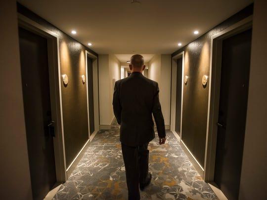 General Manager Scott Sloan walks down a hallway on