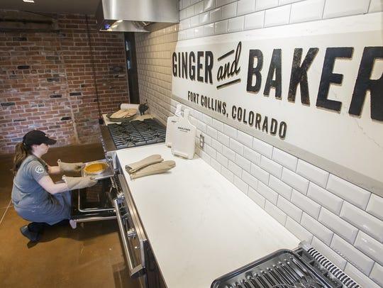 Head baker Rachel Brickel rotates pumpkin pies midway