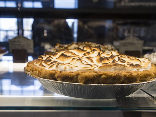 A lemon meringue pie sits in the display case on Friday,