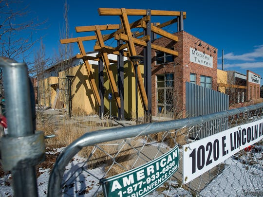 The construction site for the Red Truck Beer Company, formerly the Fort Collins Brewery, is fenced off for safety, Friday, Dec. 22, 2017, in Fort Collins, Colo.