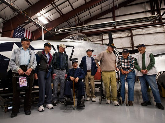Northern Colorado-based World War II veterans pose together in front of a Republic P47D-40 Thunderbolt fighter plane on May 5, 2018, at the National Museum of World War II Aviation in Colorado Springs, Colorado.