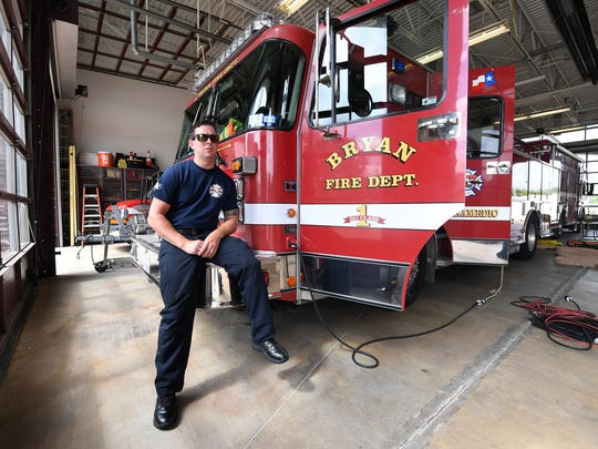 Bryan firefighter Rayse Richardson talks Friday about his recent return to work at Bryan Fire Station 1. Richardson, who has been diagnosed with brain cancer, underwent surgery this past fall.