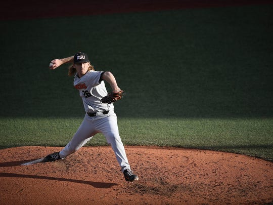 Oregon State's Bryce Fehmel pitches in Game 2 of the