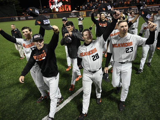 Oregon State players celebrate after defeating Minnesota to clinch the Corvallis Super Regional at Goss Stadium on June 9, 2018