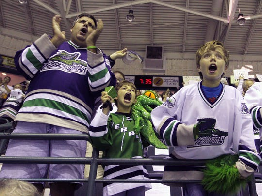 Florida Everblades fans cheer during Game 5 of the Kelly Cup Finals against the Las Vegas Wranglers on Wednesday, May 23, 2012, at Germain Arena in Estero.