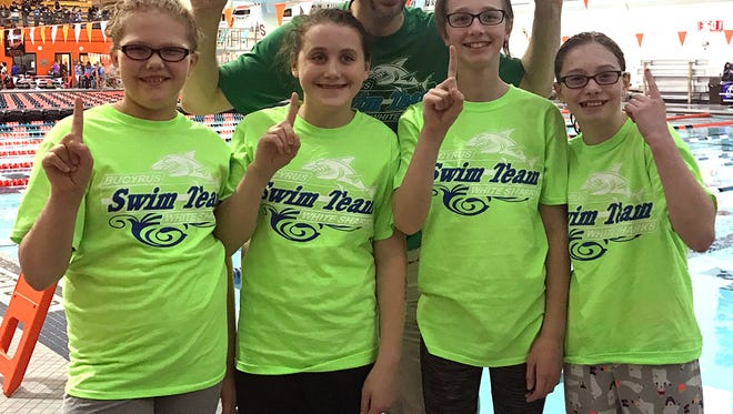 The White Sharks 10 & Under girls first place freestyle and medley relay team members, pictured with Head Coach Nate Parsons, include (left to right) Ashtyn Rickel, Miranda Stone, McKena Ward and Emma Montgomery.