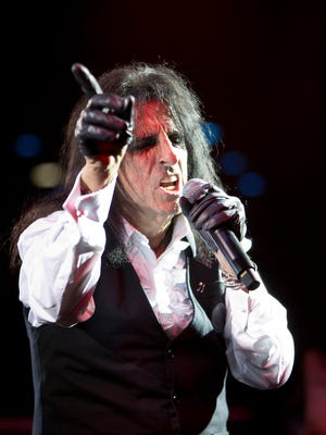 Alice Cooper performs along with his touring band at Alice Cooper's Christmas Pudding Fundraiser concert at the Celebrity Theatre in Phoenix, Saturday, December 9, 2017.