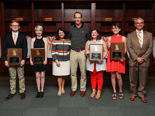 With Peyton Manning at a scholarship presentation are Blake Turpin of Knoxville; Grace Neiman of West Point, Nebraska; University of Tennessee Chancellor Beverly Davenport; Emma Kate Hall of Lebanon, Tennessee; Sydney Peay of Spring Hill, Tennessee; and interim Provost John Zomchick.