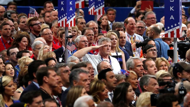 Audience members listen to the national anthem at the Republican National Convention in Cleveland on Thursday.