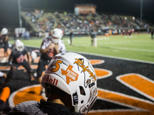 A Refugio player warms up before their game on Friday,