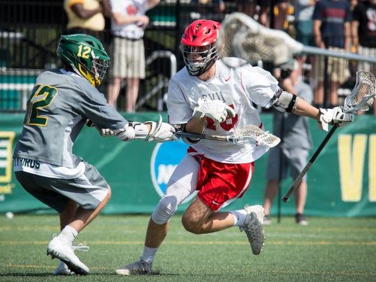 CVU's Sam Sturim carries the ball during Saturday's