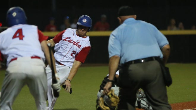 The Hays Larks' Corbin Truslow reaches for home plate before being tagged out by the catcher. The Larks fell 4-2 to the Denver Cougars on Friday night at Larks Park.