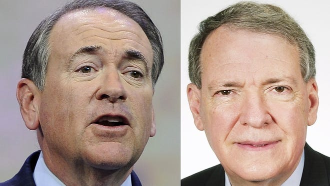 Former Arkansas Gov. Mike Huckabee and former U.S. Rep. Charles Taylor.