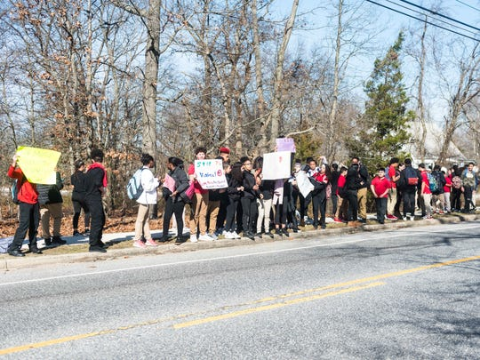 Students protest gun violence outside of Thomas W.