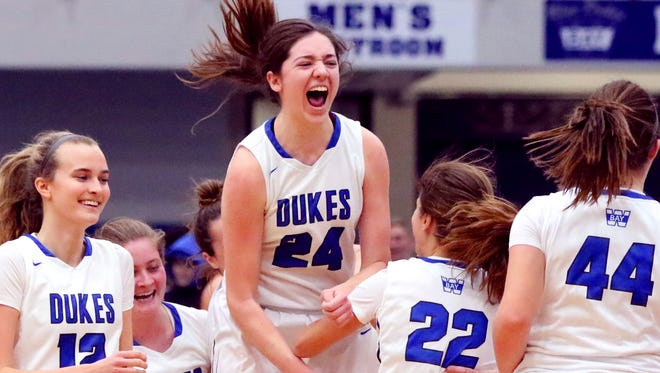 Whitefish Bay's Ellie Clements and teammates celebrate its 29-28 win over Homestead at Whitefish Bay on Feb. 6. Whitefish Bay trailed Homestead all night until the last 1:15 of the game.
